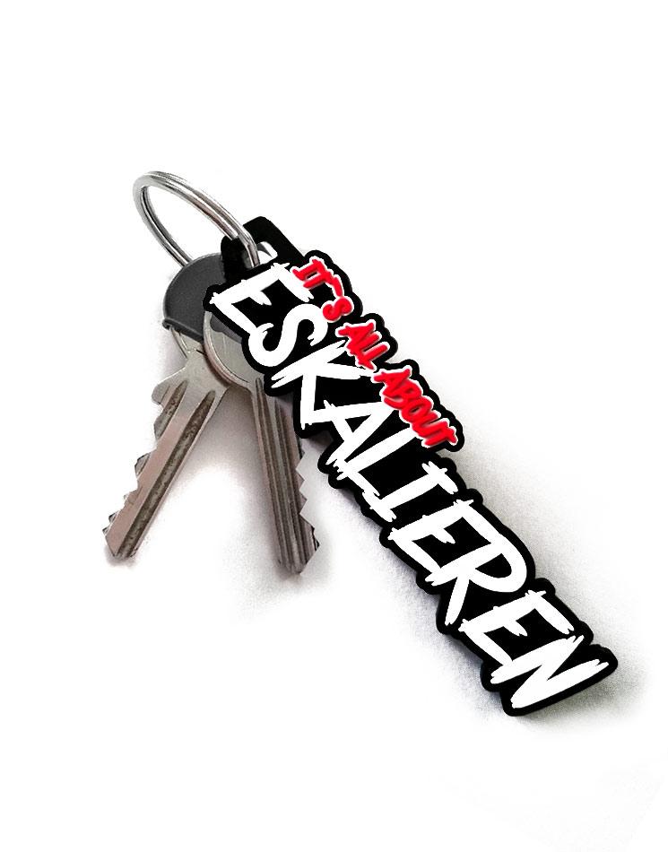 Its all about Eskalieren - Schlüsselanhänger mehrfarbig auf schwarz